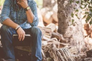 brentwood christian cousneling - man sitting by tree pondering